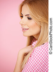 Smiling blond woman in checkered blouse