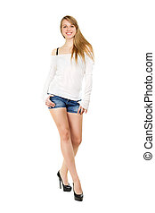 Smiling blond woman wearing blue jeans shorts and white...