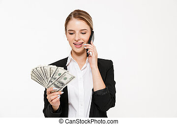 Smiling blonde business woman talking by the smartphone