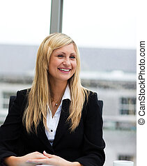 Smiling blonde businesswoman talking to a colleague
