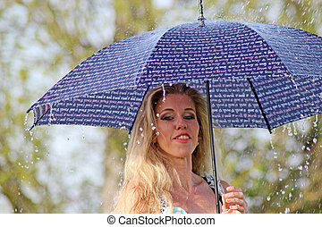 smiling blonde girl in the dress with umbrella, rainy weather