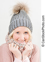 Smiling Blonde Lady Wearing Winter Beanie and Scarf