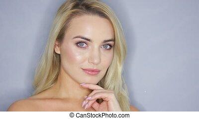 Smiling blonde model in studio