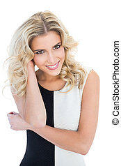 Smiling blonde model looking at camera
