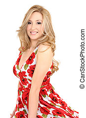 Smiling adult woman wearing a red floral dress
