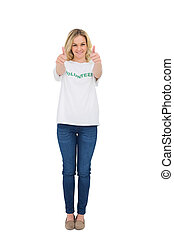 Smiling blonde volunteer giving thumbs up to camera