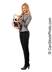 Smiling blonde with a handbag. Isolated