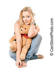 Smiling blonde with a teddy bear. Isolated