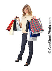 Smiling blonde with paper bags full body