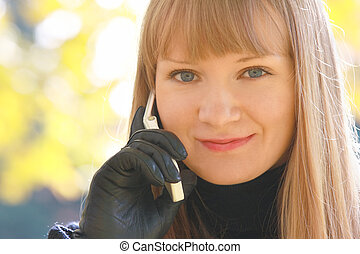 Smiling blonde with phone