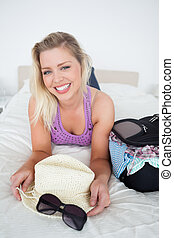 Smiling blonde with suitcase