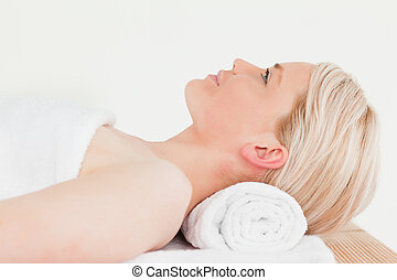 Smiling blonde woman enjoying her treatment in a Spa centre