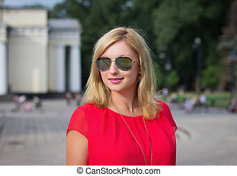 Smiling blonde woman in sunglasses