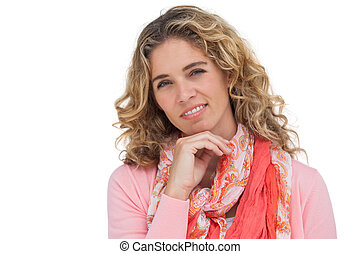 Smiling blonde woman posing with her hand on her chin