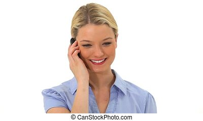 Smiling blonde woman talking on the phone