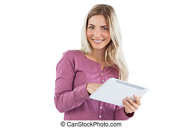 Smiling blonde woman using tablet pc