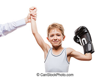 Smiling boxing champion child boy gesturing for victory...
