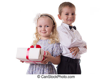 Smiling boy and girl with present box
