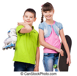 smiling boy and girl with skate and rollers