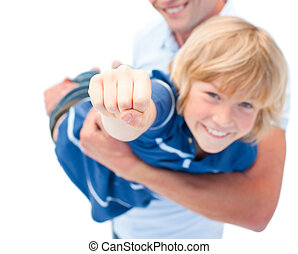 Smiling boy enjoying piggyback ride with his father