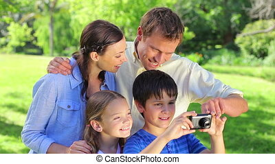 Smiling boy holding a digital camera