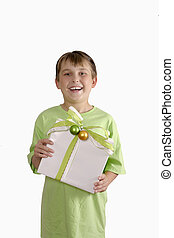 Smiling boy holding a gift