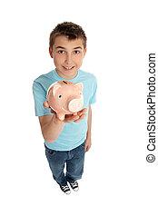 Smiling boy holding a pink pig money box