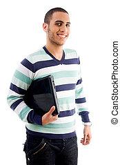 smiling boy holding laptop