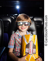 Smiling Boy Holding Popcorn In 3D Theater