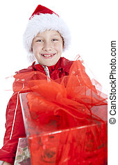 smiling boy holding present over white