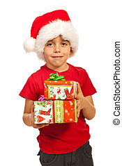 Smiling boy holding Xmas gifts
