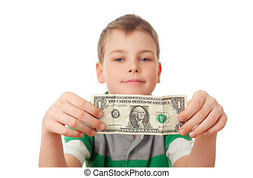 smiling boy holds one dollar in both hands isolated on white...