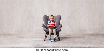 Smiling boy in 3d glasses at home
