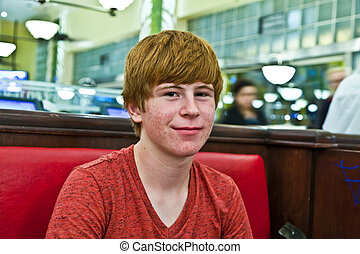 smiling boy in a diners at night