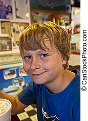 boy in a diners - smiling boy in a diners