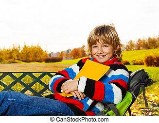 Smiling boy in autumn park