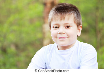 Smiling boy in forest