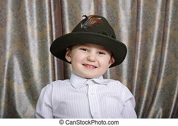 Smiling boy in hat