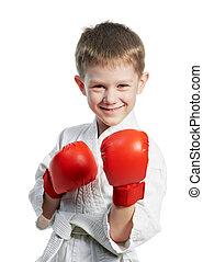 smiling boy in karate kimono with gloves
