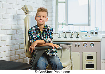 Smiling boy in Otolaryngologist cabinet at clinic