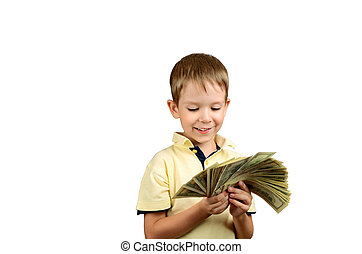 smiling boy looking at a stack of 100 US dollars bills