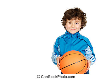Smiling boy looking at camera with a basket ball