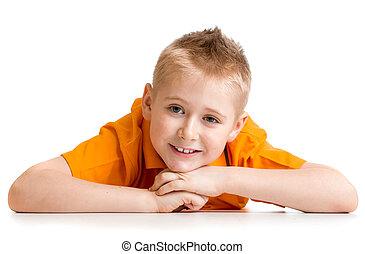 Smiling boy lying on floor isolated on white