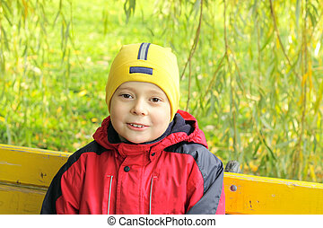 Smiling boy on bench