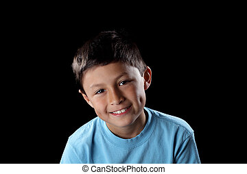 Smiling boy on black background
