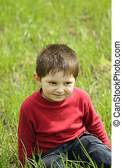Smiling boy on grass