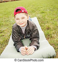 Smiling boy on mat