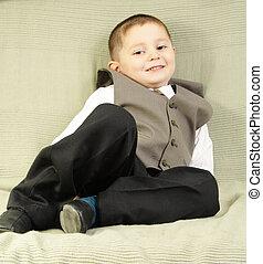 Smiling boy on sofa
