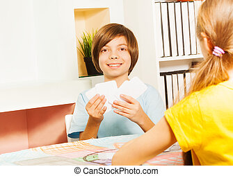 Smiling boy playing game with cards