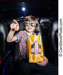 Smiling Boy Pointing While Watching 3D Movie